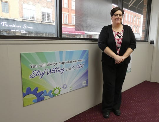 Heather Smith, the new executive director of Crawford Works, stands in the front of the organization's office on North Sandusky Avenue.