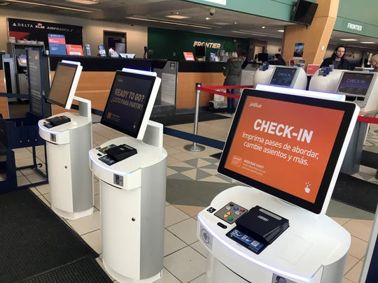 Empty check-in terminals at Burlington International Airport on Wednesday, March 18, 2020.