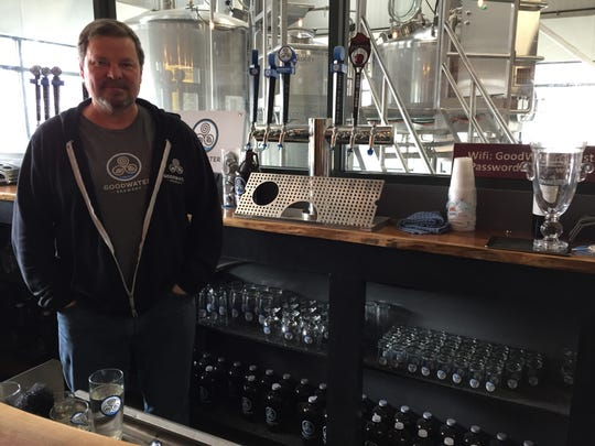 Marty Bonneau, owner of GoodWater Brewery, stands in his Williston brewery March 19, 2020. He can't serve pints of beer from his taps now that the state has told bars and restaurants to stop serving sit-down diners and drinkers until April 6 because of the COVID-19 outbreak.