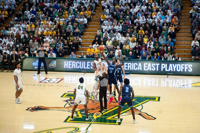 The tip-off for the Maine at Vermont men's basketball America East quarterfinal game on March 7.