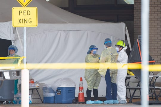 Medical screeners prepare to test residents Thursday March 19, 2020 in Corpus Christi. The city was one of many places around the country that had set up drive-thru testing centers to increase screening for the deadly virus.