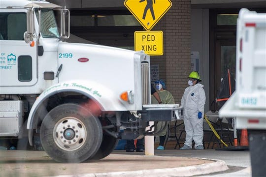 Medical screeners prepare to test residents on Thursday March 19, 2020 in Corpus Christi. The city was one of many places around the country that had set up drive-thru testing centers to increase screening for the deadly virus.