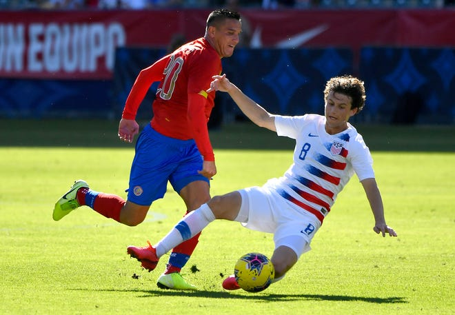 Medford native Brenden Aaronson, right, played 66 minutes in his debut for the national team against Costa Rica on February 1.
