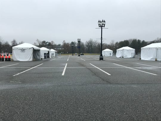 Small tents are spaced several feet apart in the parking lot at Camden County College, a mobile testing site that officials hope will be operational soon.