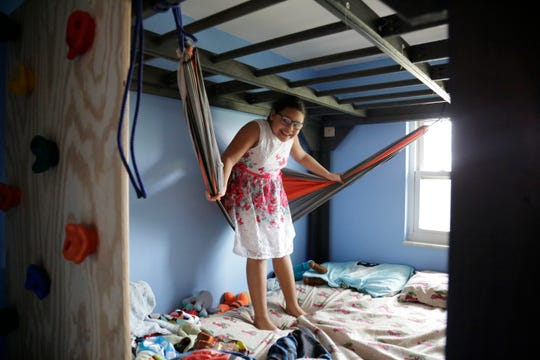 Kaylee Woodward, 9, a third grader at Seipelt Elementary, demonstrates the special room in her house designed for her brother Mogan, 8, who has autism at their home in Milford, Ohio, on Thursday, March 19, 2020.
