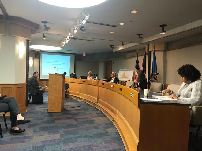 Hamilton County commissioners practice social distancing on March 19, 2020.