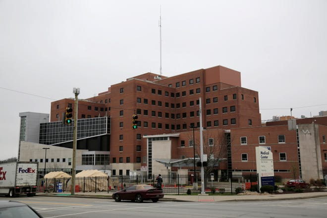 Tents are set up outside the Veterans Affairs hospital in the Avondale neighborhood of Cincinnati on Thursday, March 19, 2020.