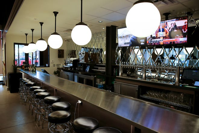 The bar at the Sacred Beast restaurant sits empty after Gov. Mike DeWine ordered the closure of sit-in dining in the state's restaurants, Thursday, March 19, 2020.