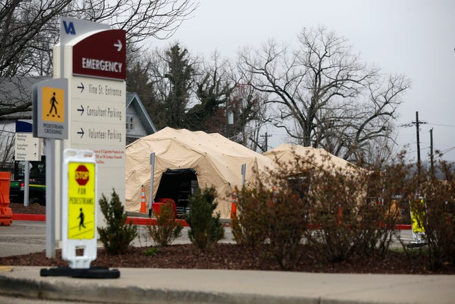 Tents are set up outside the Veterans Affairs hospital in the Corryville neighborhood of Cincinnati on Thursday, March 19, 2020.