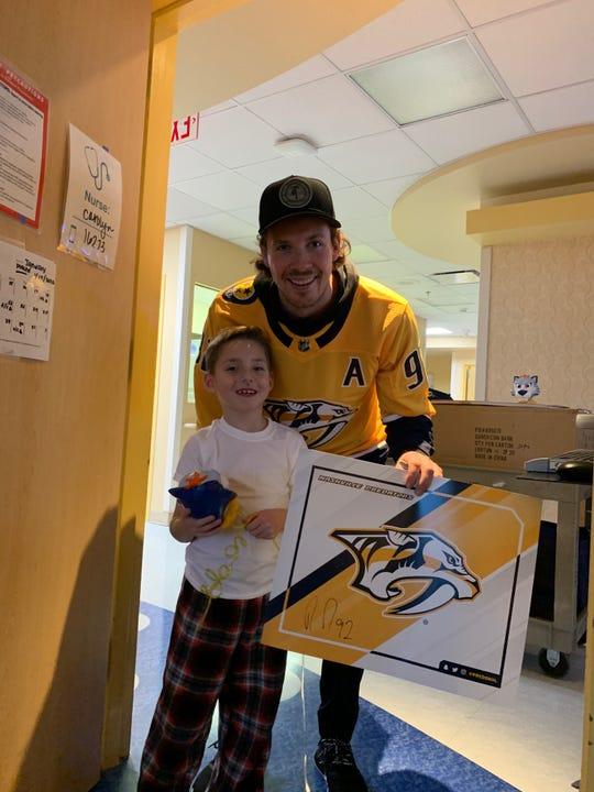 Ryan Johansen of the Nashville Predators visits 6-year-old Joseph Bostain during his stay at Vanderbilt University Medical Center in January 2020.