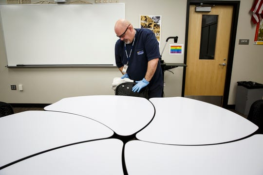 Des Moines Register photographers continue covering news and events in our communities, such as this Brian Powers photo of Des Moines Public Schools employee Ron Bainter as he cleaned and sanitized an engineering classroom at Central campus on Thursday.
