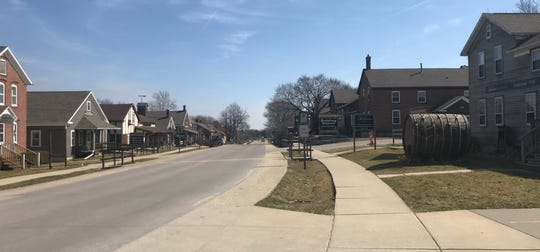 The sidewalks were empty on 220th Trail in Amana on Tuesday, an hour after dine-in restaurants were ordered to close in Iowa to try to stem the spread of the coronavirus. This week traditionally marks the beginning of the tourism season in the community of 1,500.