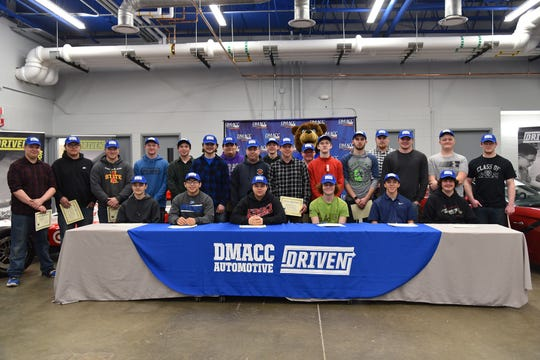 The first of this fall's DMACC Automotive Technology Programs student sign commitment to attend the community college.