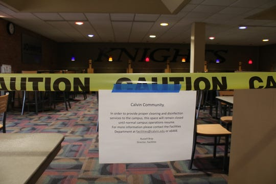 A sign tells anyone left on Calvin University's campus in Grand Rapids there's no more sitting around for lunch in common areas.
