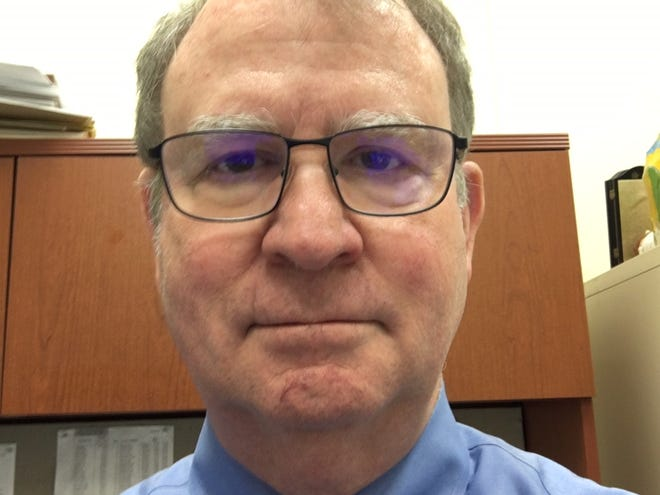 Charles Ballard, economics professor at Michigan State University, prepares to do an online-only class during the coronavirus crisis.