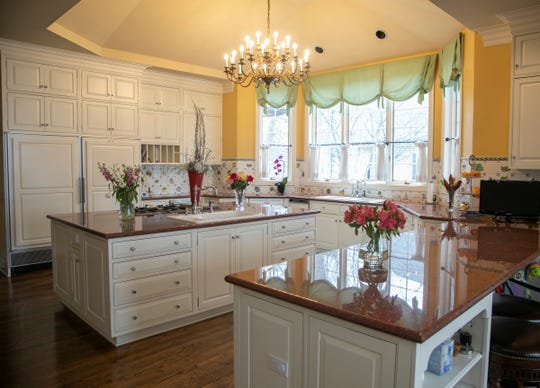 Kitchen with large island in this  23 room lake-front estate in Orchard Lake features 7 bedroom suites and regal two story foyer. The house, that was photographed Wednesday, March, 18, 2020 has front property that extends to the Orchard Lake Country Club's golf course.