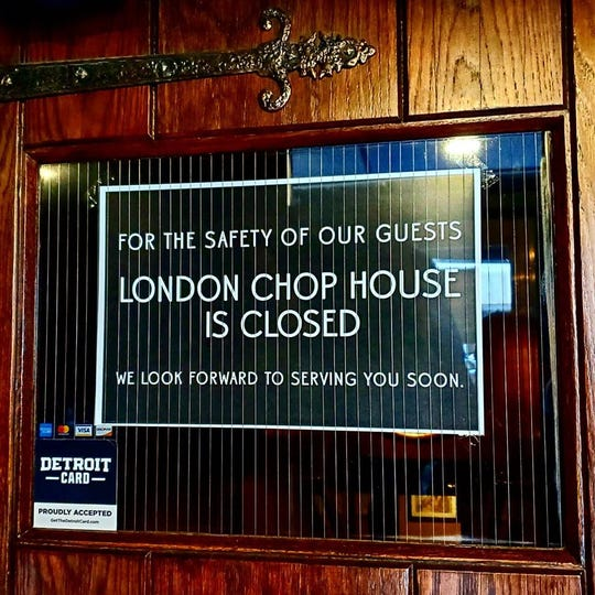 """The """"closed"""" sign on the door at the London Chop House"""