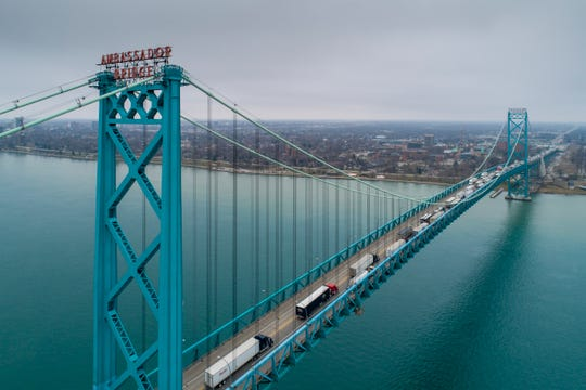 Vehicles are seen traveling from the American side of the Ambassador Bridge in Detroit to the Canadian side in Windsor, Ontario, Thursday.