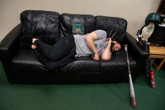 Ohio University senior outfielder Ryan Sargent naps on a couch in the team locker room shortly after finding out the NCAA had cancelled all spring sports due to the COVID-19 pandemic, on Friday, March 13, 2020, in Athens, Ohio.