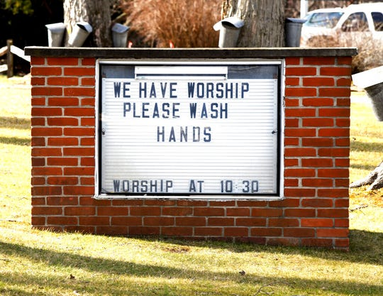 This Monday March 16, 2020 file photo shows a reminder regarding personal hygiene in lieu of the spreading COVID-19 coronavirus on the sign outside the Austinburg First United Church in Austinburg Township, Ohio.