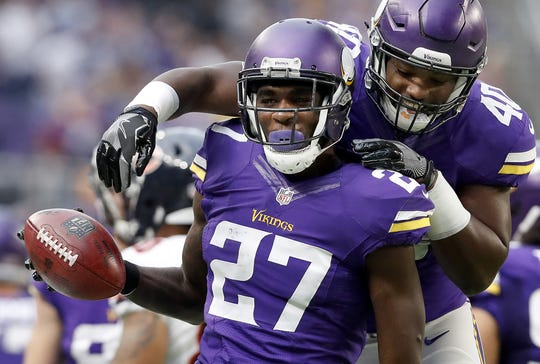 The Minnesota Vikings' Jayron Kearse (27) celebrates with Kentrell Brothers after recovering a muffed punt in the second quarter against the Chicago Bears at U.S. Bank Stadium in Minneapolis on Sunday, Jan. 1, 2017.