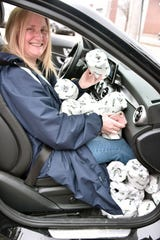 Laura Duncan of Gaylord is surrounded by rolls of toilet tissue after buying surplus rolls at the Great Lakes Tissue Company of Cheboygan.