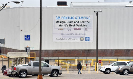 A sole UAW worker walks to his vehicle at the end of his shift at the GM Pontiac Stamping plant on E. Beverly, Wednesday, March 18, 2020.