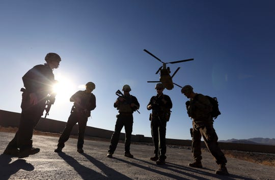 American soldiers wait on the tarmac in Logar province, Afghanistan on Nov. 30, 2017.