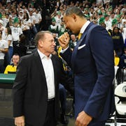 Tom Izzo (left) and Juwan Howard are part of a collection of Michigan and Michigan State coaches who teamed up for a public service announcement regarding the fight against the coronavirus.