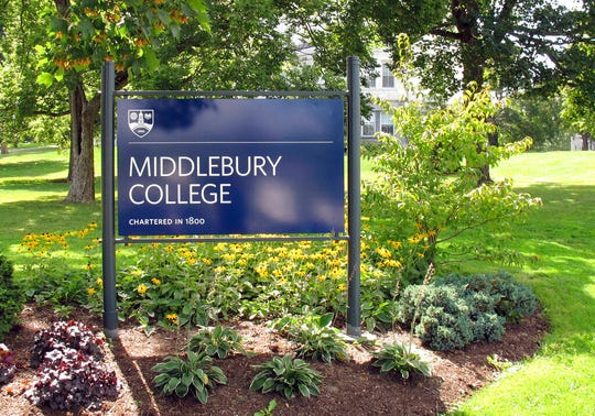 This Aug. 31, 2017, file photo, shows a sign for Middlebury College on the campus in Middlebury, Vt. Middlebury College in Vermont said it's offering some of its buildings as local officials craft emergency plans to help combat the coronavirus outbreak.