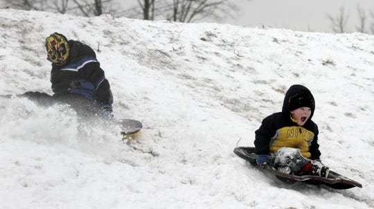 Children sled at Jim Nelson Park on West Hudson Street in Elmira. The park occupies much of the former site of the Wilson Driving Park.