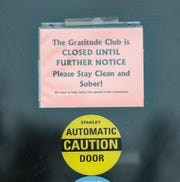 A sign on the Gratitude Club door Thursday, March 19, 2020 in Fond du Lac, Wis. announces it is closed.