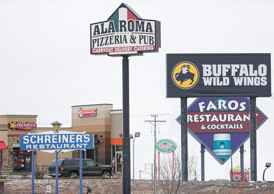 A composite illustration of restaurants on West Johnson Street on Wednesday, March 18, 2020. Fond du Lac restaurants are adjusting after Gov. Evers ordered eateries to no longer offer sit-down dining.