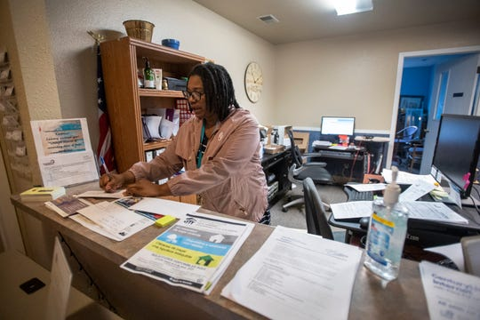Gia Heflin, the lead housing counselor for Neighbor to Neighbor, assists a client in the office at Neighbor to Neighbor in Fort Collins, Colo. on Thursday, March 19, 2020.