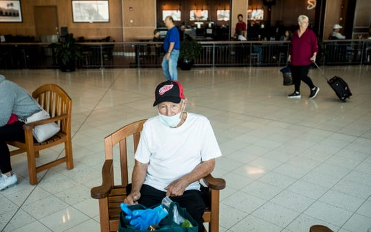 Virgil Richards, 88, a part time resident of Southwest Florida waits for his delayed flight at Southwest Florida International Airport onThursday March 19, 2020. He and his wife were heading back to Bay City,  Michigan.