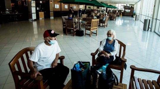 Virgil Richards, 88, and his wife Clarice, both part time residents of Southwest Florida wait for their delayed flight at Southwest Florida International Airport onThursday March 19, 2020. They are heading back to Bay City,  Michigan.