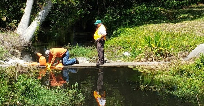 Workers try to stem the flow of raw sewage in Manuels Branch from what may be the biggest spill in Fort Myers history.