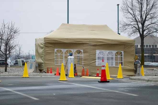 A tent being set up for COVID-19 testing on Thursday at Aurora BayCare Medical Center, 2845 Greenbrier Road, in Green Bay.