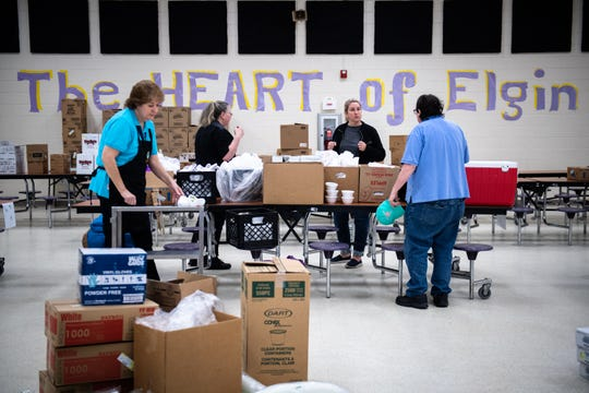 Kershaw County school district staff organize food to be loaded on buses to be delivered to students along their respective routes Wednesday, March 18, 2020, in response to the closing of all public schools in South Carolina as a result of the coronavirus outbreak.