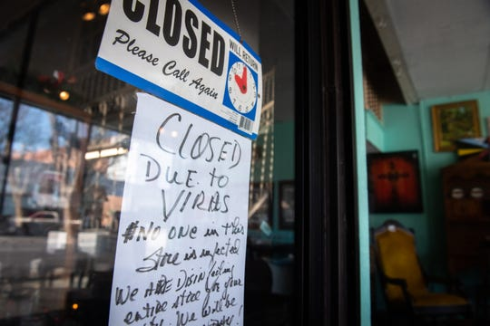 A sign on the door of a store on Broad Street in Camden letting customers know they are closed due to the coronavirus Wednesday, March 18, 2020. Kershaw County has the highest number of cases of the virus in South Carolina.