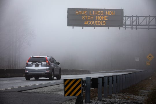 A sign at the South Carolina border with North Carolina on route 25 south urging people to stay home in response to the coronavirus outbreak, Thursday, March 19, 2020.
