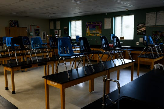 Chairs sit on top of desks in a classroom that has been deep cleaned at League Academy Thursday, March 19, 2020.