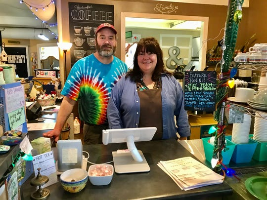 Kristen Coward Heiselman and Gene Heiselman inside the TreeHouse Cafe & Studio  they own at 27 S. Main St. in Travelers Rest.