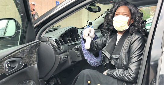 Ida Brock of Greenville wears a face mask and keeps hand sanitizer on hand as she pulls up to the Project Host soup kitchen in downtown Greenville on Thursday, March 19, 2020, amid the global COVID-19 outbreak.