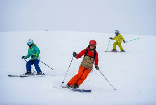 Skiers enjoy the snow at Showdown on Wednesday afternoon, March 18, 2020.
