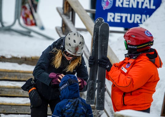 Audrey Scherrer, of St. Louis, MO, helps her son Rod with his ski goggles before heading out for a day of skiing at Showdown on Wednesday, March 18, 2020.  The Scherrer family had planned to be at Big Sky Ski Resort for their ski vacation but adjusted their plans when Big Sky closed due to concerns over the coronavirus.