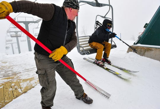 Eric Campbell, a lift operator at Showdown, grooms the offloading area at the top of the lift on Wednesday afternoon, March 18, 2020.