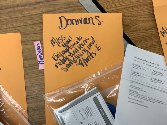 Erin Evenhus, a 5th grade teacher at Sacajawea Elementary, wrote notes to her students on her coursework packets during the coronavirus pandemic that has prompted the closure of all K-12 schools in Montana.