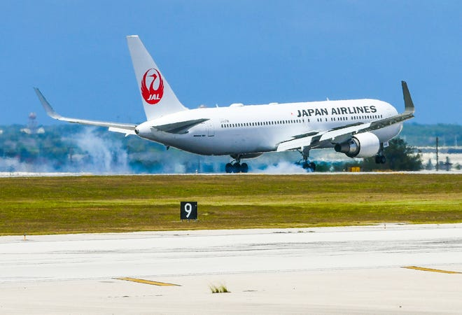 A Japan Airlines flight from Narita, Japan, touches down at A.B. Won Pat International Airport in this March 19, 2020, file photo. Japan Airlines announced Feb. 18 that its Guam-Narita flight suspension will continue till May 31.