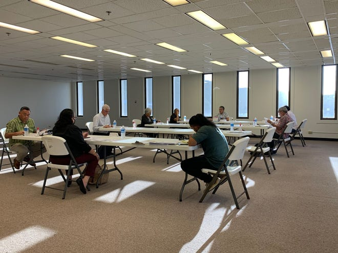 The Guam Election Commission meets Thursday afternooon at the GCIC building to discuss canceling or postponing the March 28 special election for Yona mayor because of the coronavirus pandemic. Commission members sat far apart, at the ends of long tables, to maintain proper social distance, as recommended by the governor and health officials.